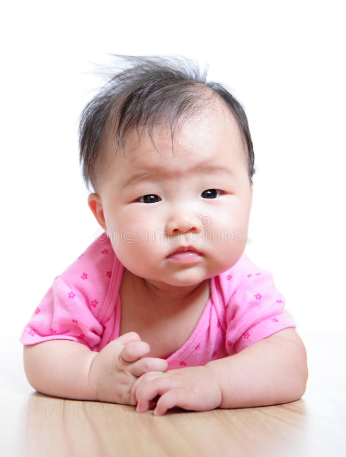 Cute girl baby confuse face close up. With pink cloth on white background stock photo
