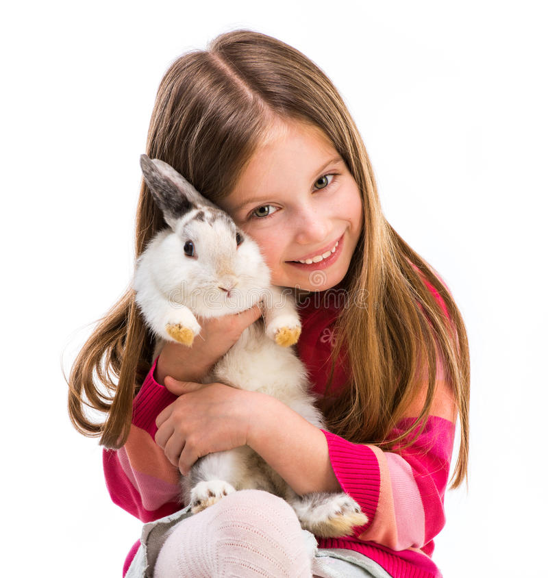 Cute girl with baby rabbit. Cute smiling girl in a crimson sweater with baby rabbit isolated close-up royalty free stock photography