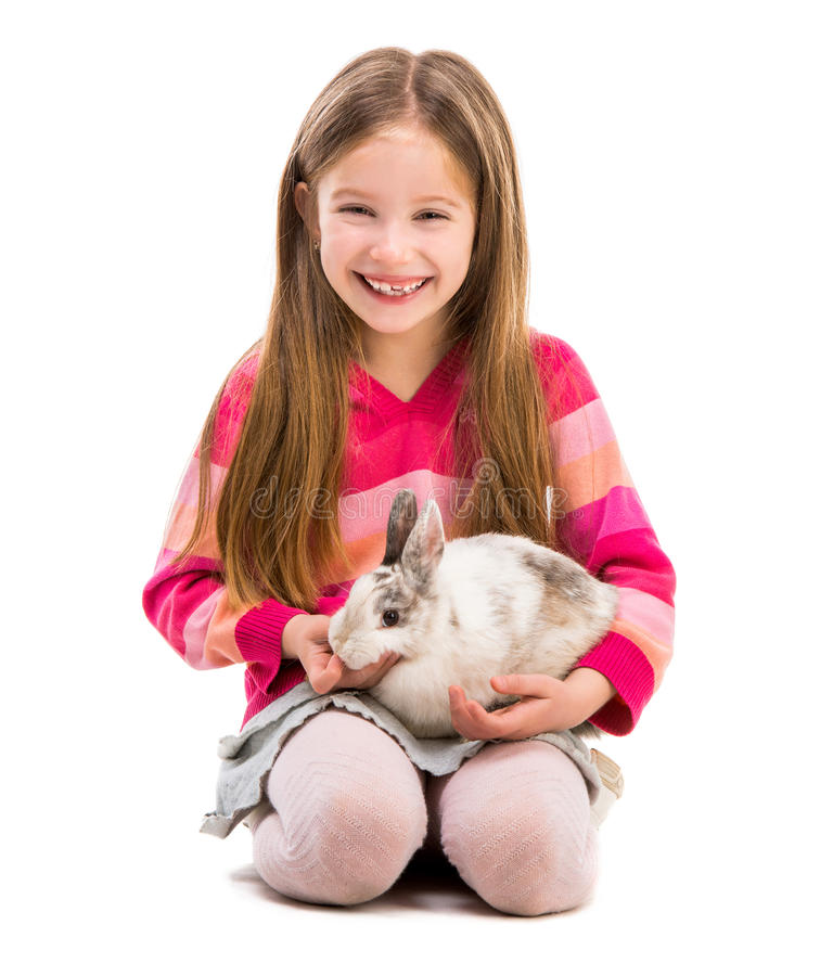 Cute girl with baby rabbit. Cute smiling girl in a crimson sweater with baby rabbit over white background stock image