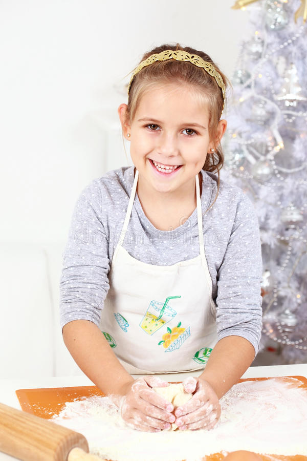 Cute girl baking cookies. For Christmas stock photography