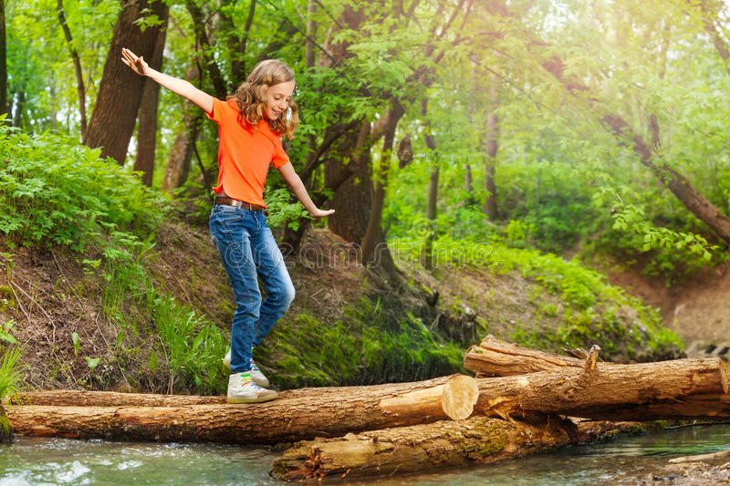 Download Cute Girl Balancing While Crossing A Log Bridge Stock Image - Image of forest, river: 80982987