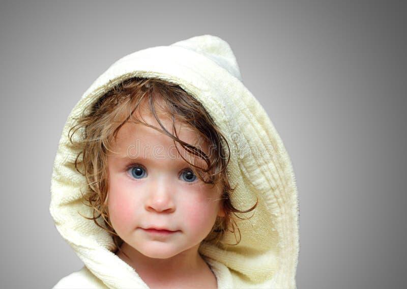 Cute girl in bathrobe portrait stock images