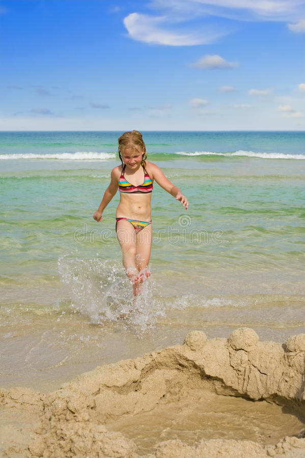 Cute girl at the beach royalty free stock photo