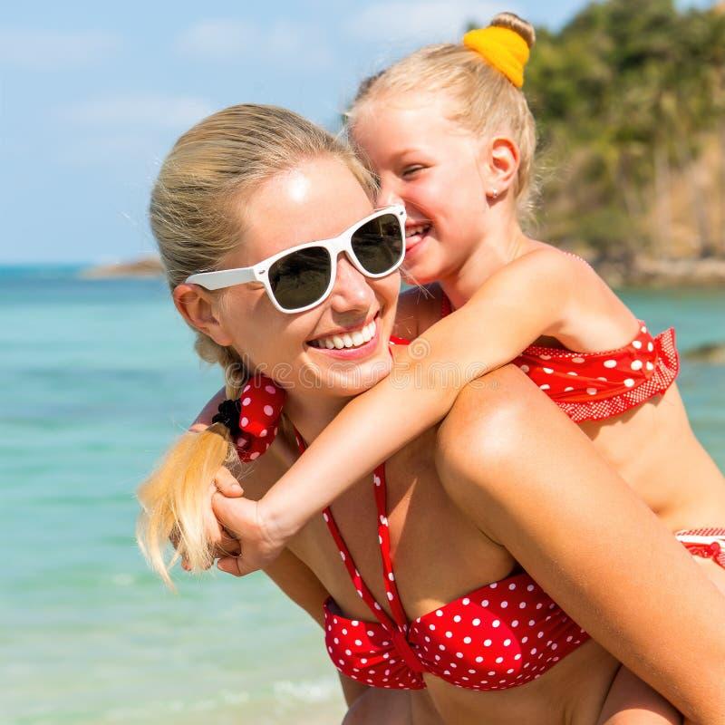 Woman With Beautiful Body In Bikini At Beach Stock Image: Cute Girl And Beautiful Mother On The Beach Stock Image