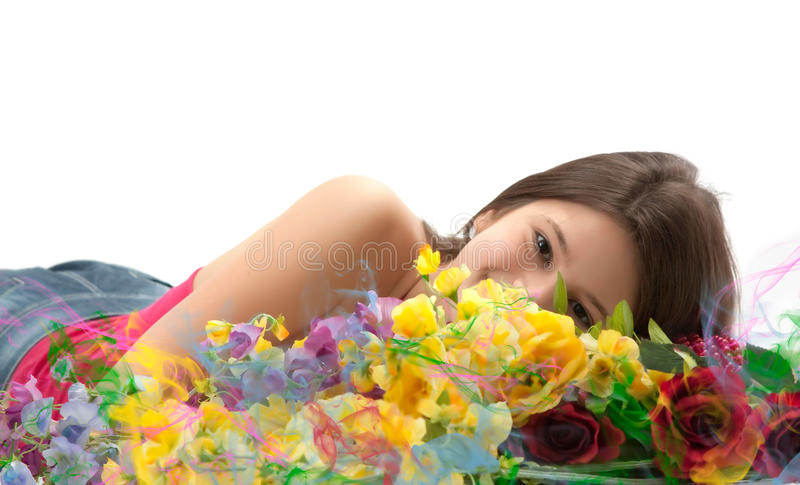 Cute girl behind flowers. Cute girl behind the flowers on a white background stock photos