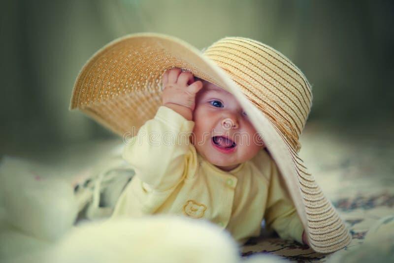 Cute girl in big hat stock photo