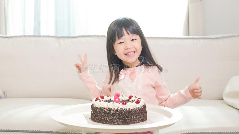 Cute girl with birthday cake. In the home royalty free stock photography