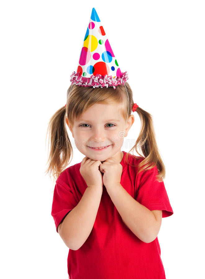 Cute girl in birthday cap. Funny girl in birthday cap isolated on white royalty free stock photos