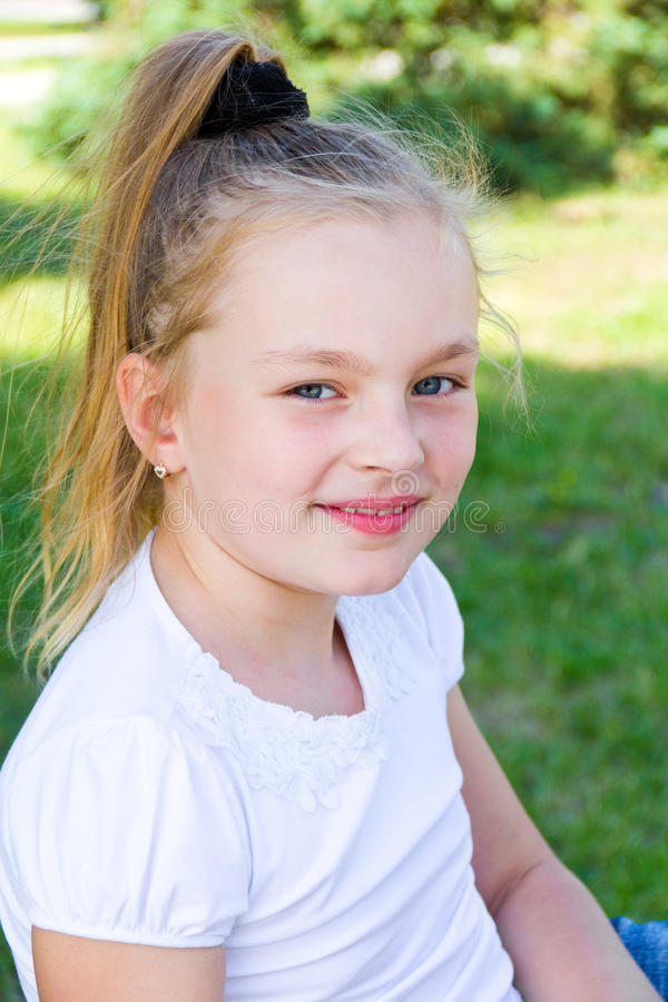 Cute girl. With blond long hair and blue eyes royalty free stock image