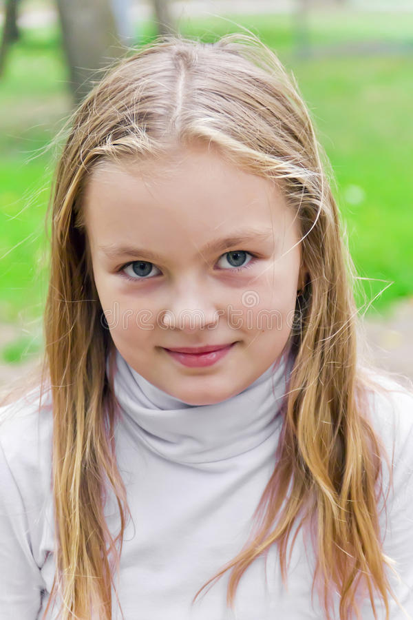 Cute girl. With blond long hair and blue eyes stock photography