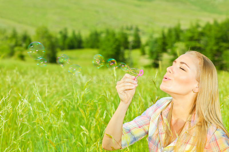 Download Cute Girl Blowing Bubbles Outdoors Stock Photo - Image: 29673222