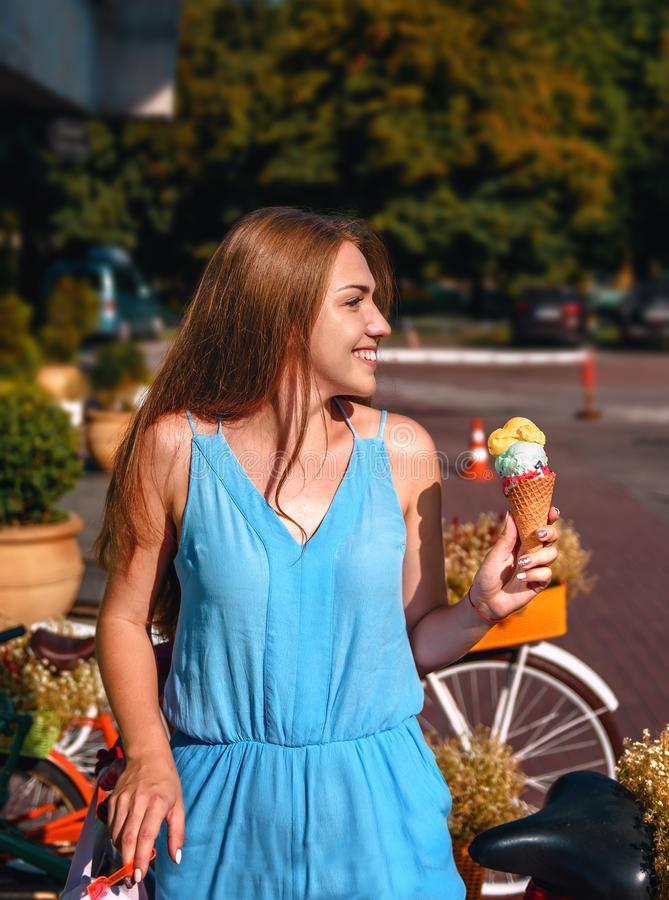 Cute girl with icecream. Cute girl in blue dress with icecream stock photo