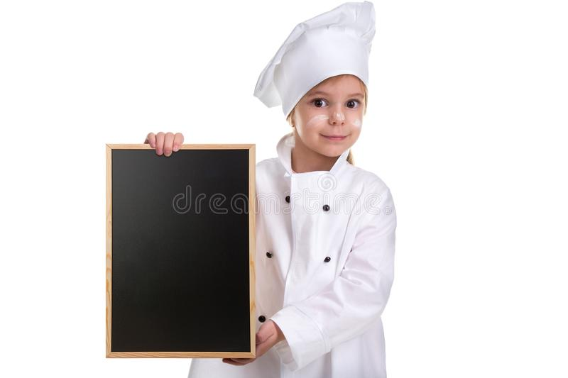 Cute girl chef white uniform isolated on white background. Girl with a floured face holding a menu black empty board stock photography