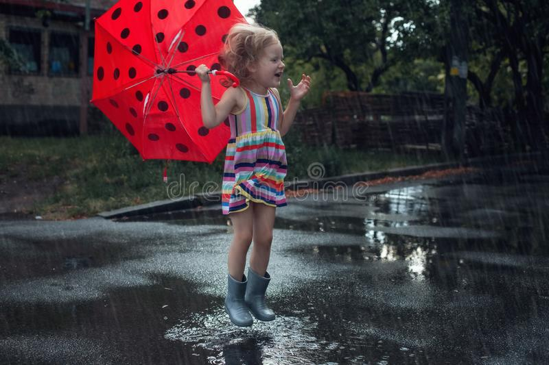 Cute girl child with umbrella stock images