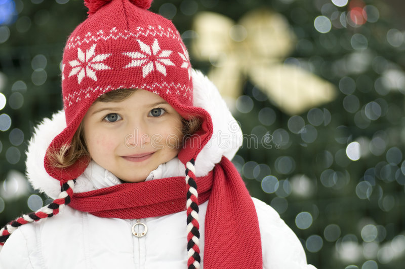 Download Cute girl at Christmas stock image. Image of gift, beanie - 7572859