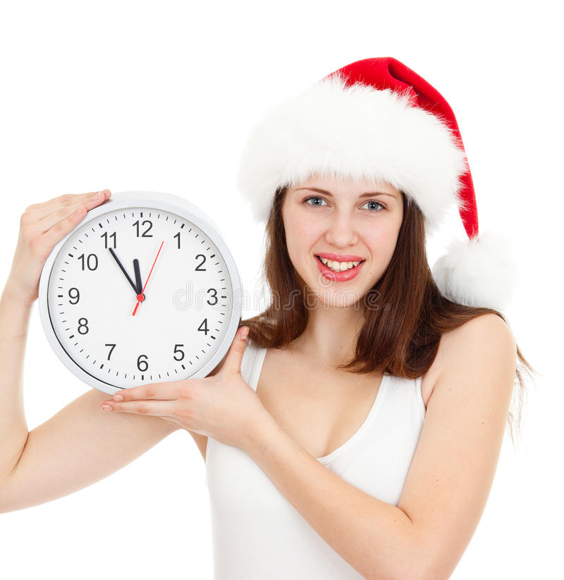 Download Cute Girl In Christmas Red Santa Hat With Clock Stock Photos - Image: 26252823