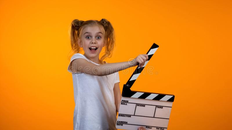 Cute girl clapping flapper dreaming to be film producer, advertisement template stock photography