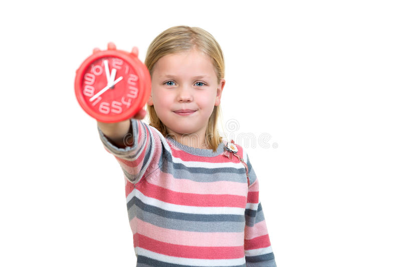 Cute girl with clock isolated over white. Background royalty free stock image