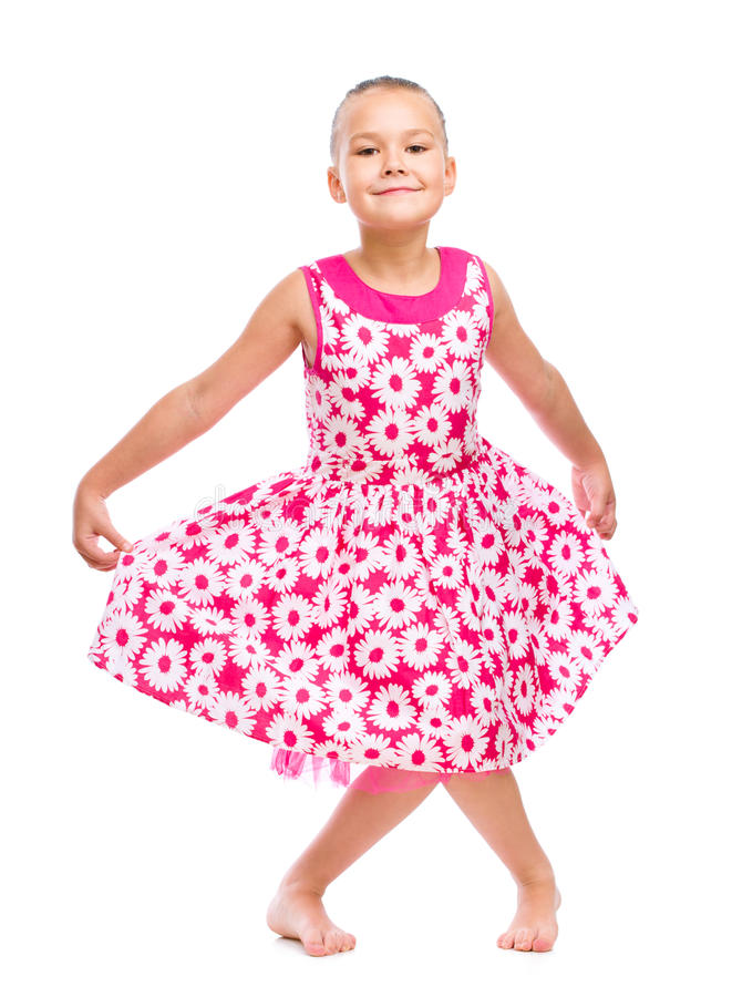 Cute girl dancing. Isolated over white royalty free stock photography