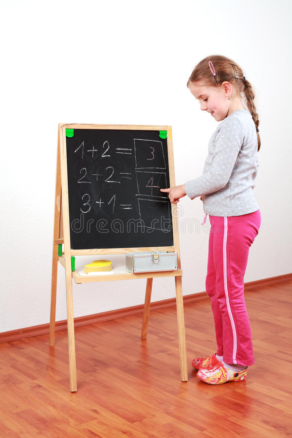 Download Cute girl doing math stock photo. Image of cute, enjoy - 22491436