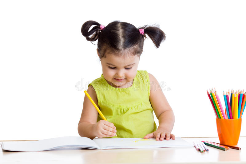 Cute girl drawing with colourful pencils royalty free stock image