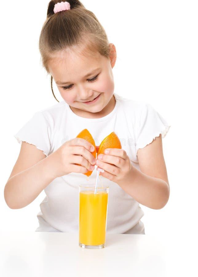 Cute girl is drinking orange juice stock images