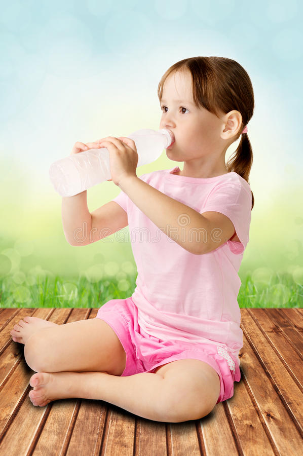 Cute girl drinking water stock images