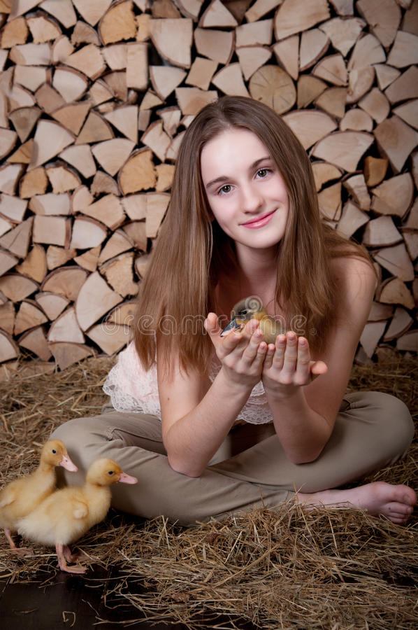Cute girl with duckling has easter stock photos