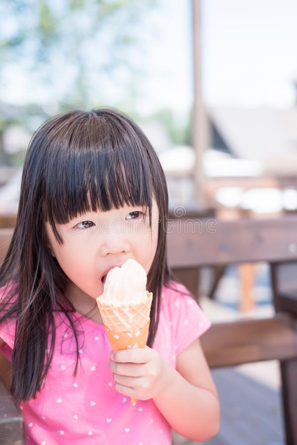 Cute girl eat ice cream. And smile happily royalty free stock photos