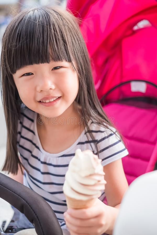 Cute girl eat icecream. And smile happily royalty free stock photo