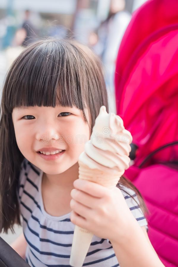 Cute girl eat icecream. And smile happily royalty free stock photography
