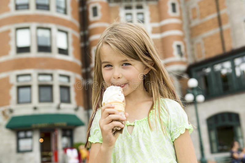Cute Girl Eating Ice-Cream. A Cute Girl Eating Ice-Cream outside on a beautuful day royalty free stock images