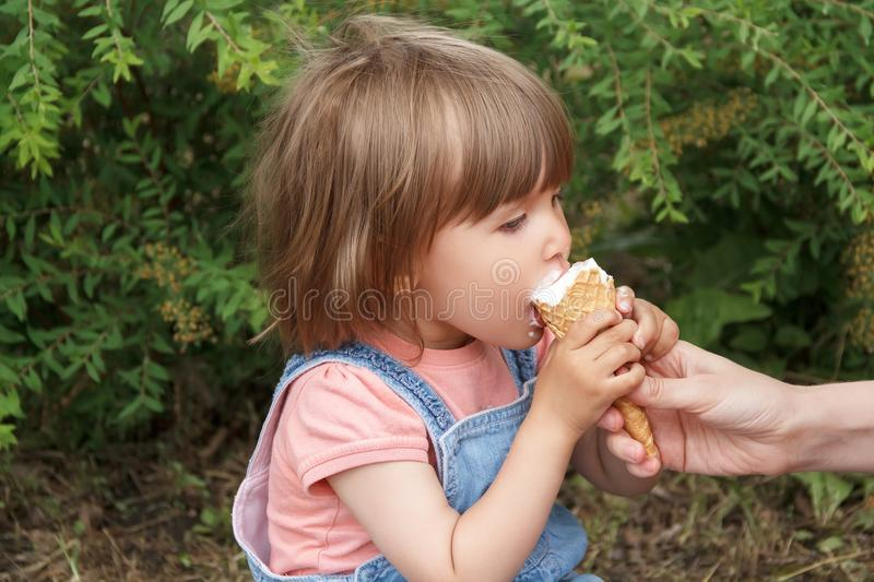 Cute girl are eating icecream. Photo of cute girl are eating icecream in summer royalty free stock images