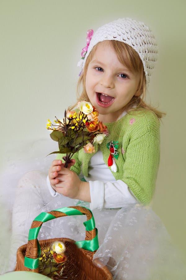 Girl enjoying spring flower blossom stock image