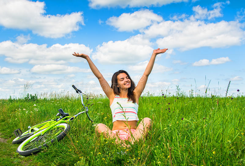 Cute girl enjoys summer after cycling cruiser stock images