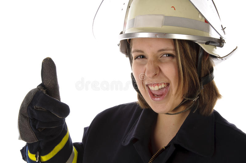 Cute girl in firefighter uniform stock photography