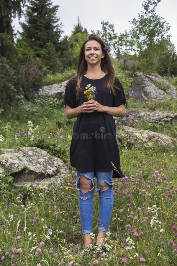 Cute girl on a flower meadow stock photo