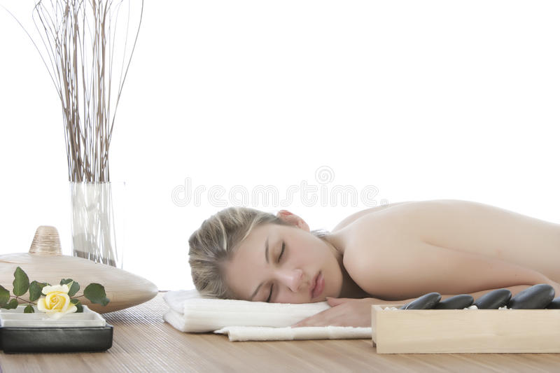 Cute girl getting a stone massage stock image