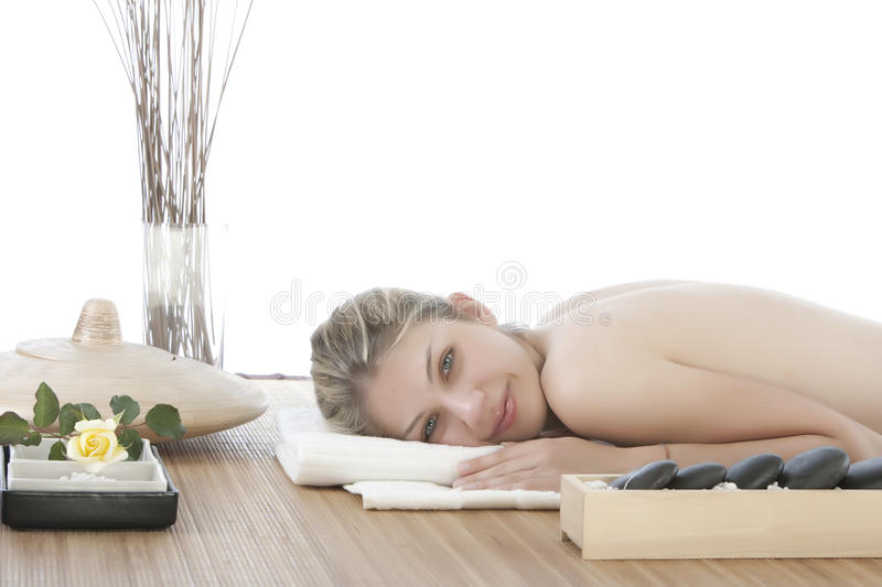 Cute girl getting a stone massage royalty free stock photo