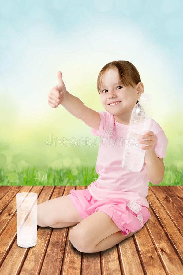 Cute girl gives the thumbs-up stock image
