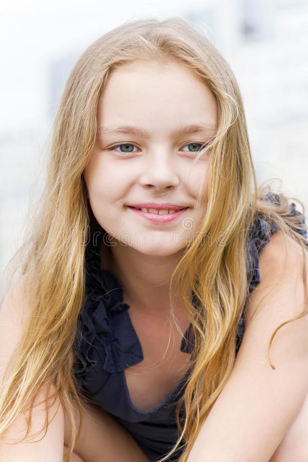 Cute girl with blond hair stock photos