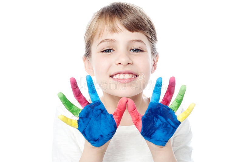 Cute girl with hands painted stock photography
