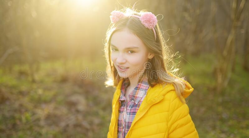 Cute girl having fun on beautiful spring day. Active family leisure with kids. Family fun outdoors royalty free stock photography