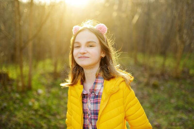 Cute girl having fun on beautiful spring day. Active family leisure with kids. Family fun outdoors royalty free stock images