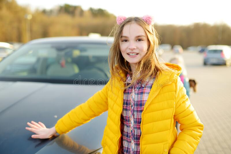 Cute girl having fun on beautiful spring day. Active family leisure with kids. Family fun outdoors stock images