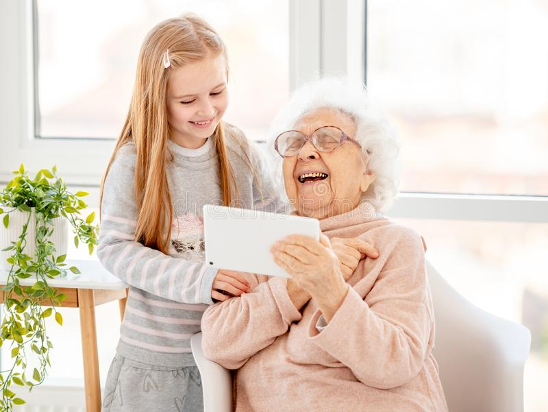 Cute girl helping old lady stock photography