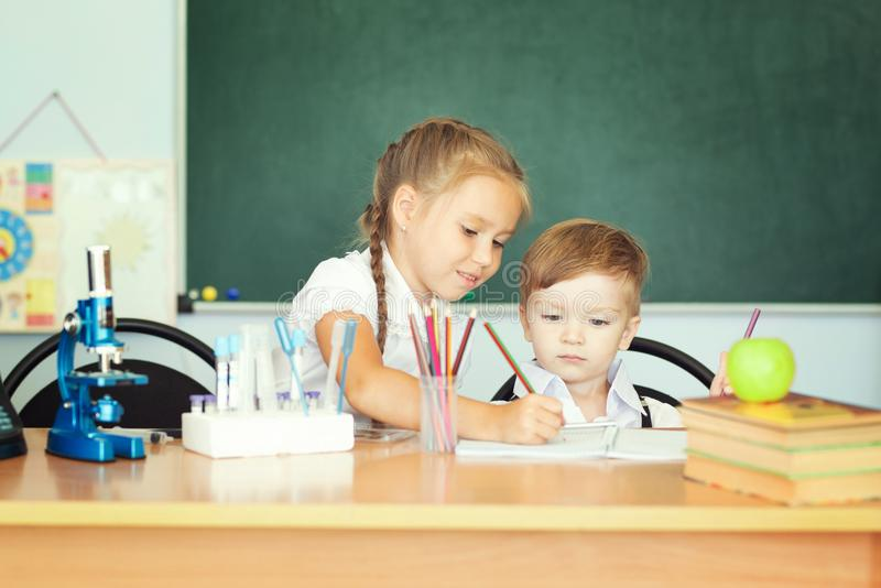 Cute girl and her little brother learning together stock photos