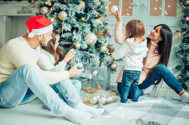 Happy girl decorating Christmas tree.Family, christmas, ,happiness concept royalty free stock photography