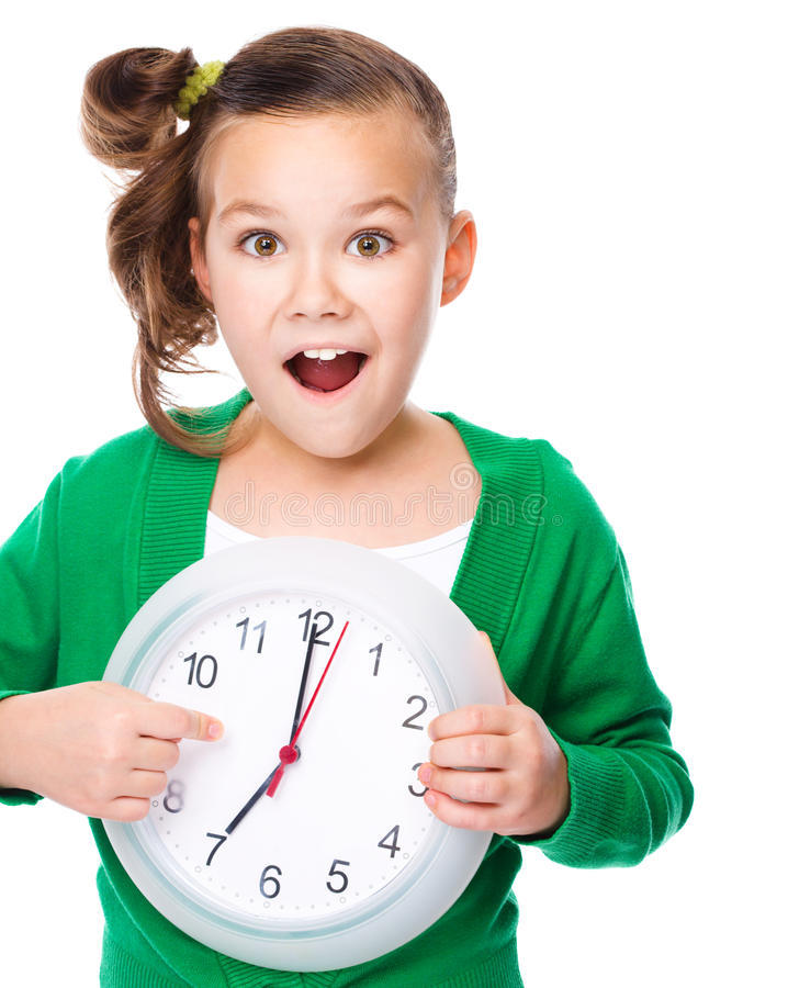 Cute girl is holding big clock royalty free stock photo