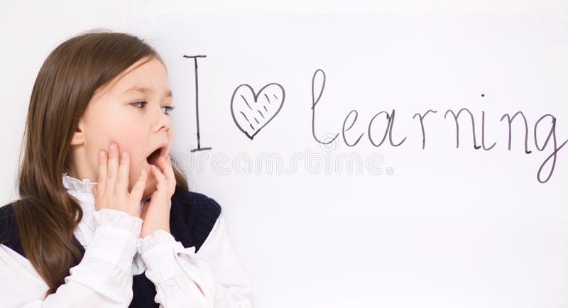 Cute girl is holding book royalty free stock image